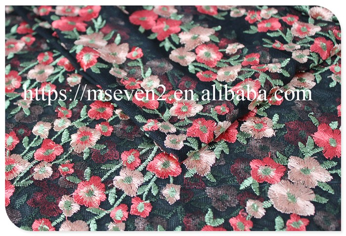 Newest design allover daisy schiffli embroidery fabrics in black tulle