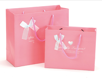 Gift packing custom printed string paper bag wholesale