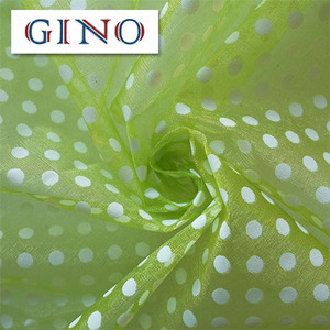 green organza fabric with white dots