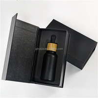 Best Selling cosmetic frosted black glass vape 30 ml dropper glass bottle for e juice
