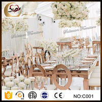 rose gold stainless steel wedding table set in center