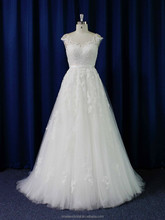 Alluring cap sleeve sheer lace boat neck covered back flowing tulle gown wedding dress
