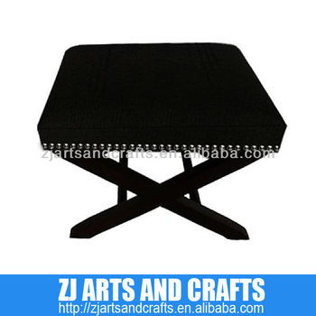 4416 living room ottoman (Black Polyester cross leg ottoman with silver studs around sides and black timber cross legs.)