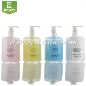 Spa mini shampoo, conditioner, shower gel, body lotion, empty tube and bottle.