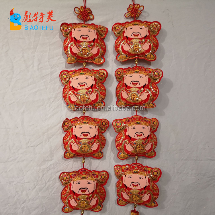 Chinese god of wealth doll hanging lucky bag string on wall