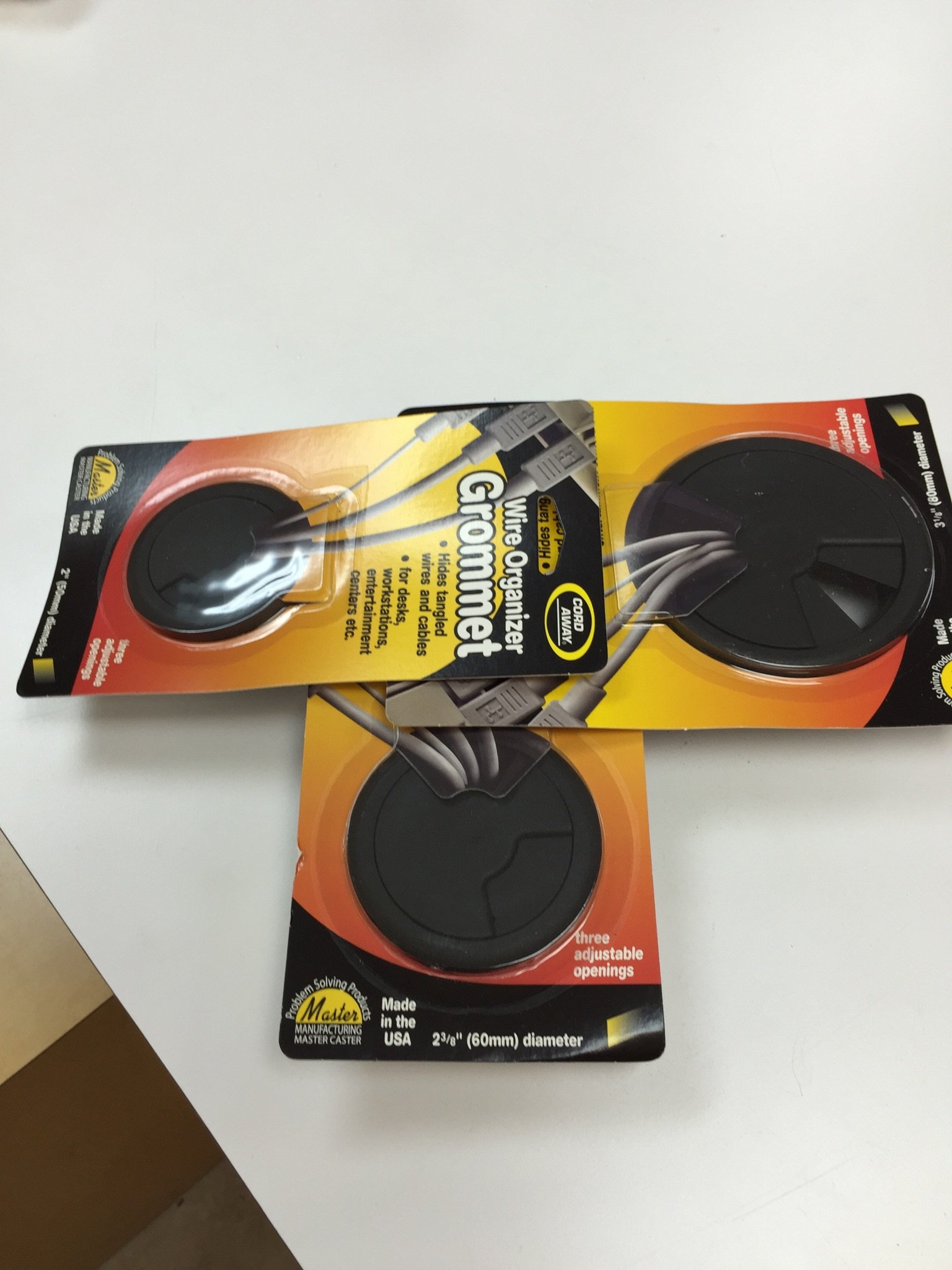 "3-Pack Round Desk Grommet Kit - Sizes 2"",2.375"" & 3.125"", Plastic, Color: Black"