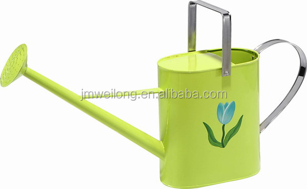 metal watering can with flower patterns