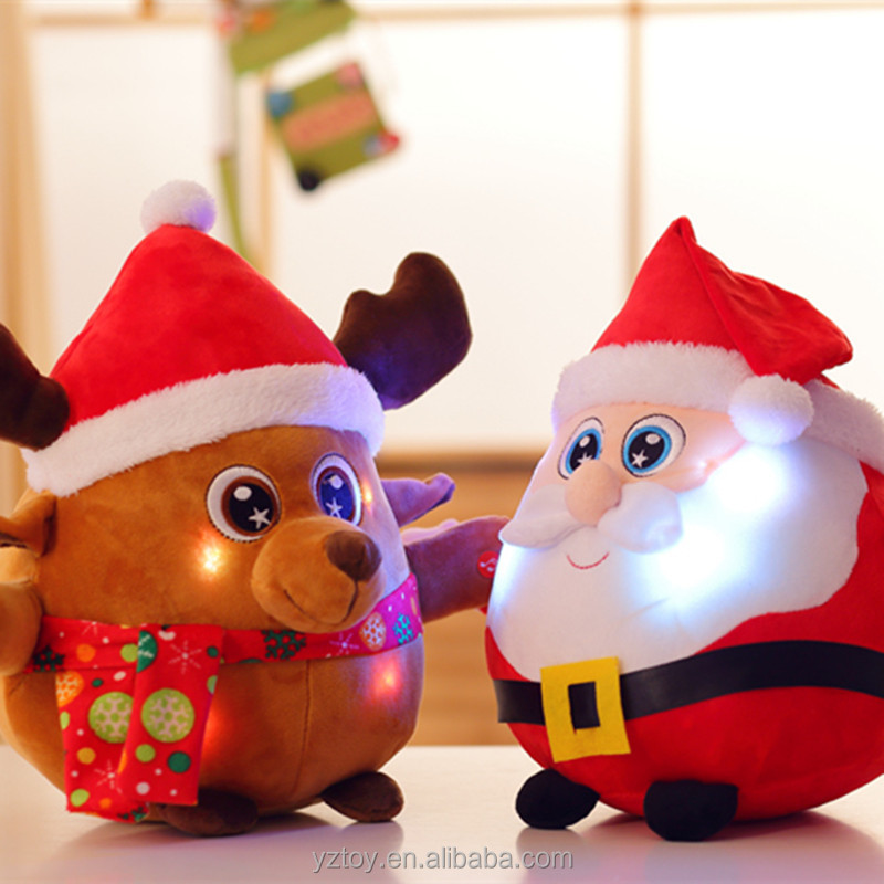 The new light music Santa Claus dolls plush toys Christmas gift.