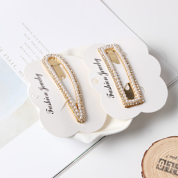 Wholesale handmade gold plating alloy pearl ponytail pieces human extensions clip on hair ons