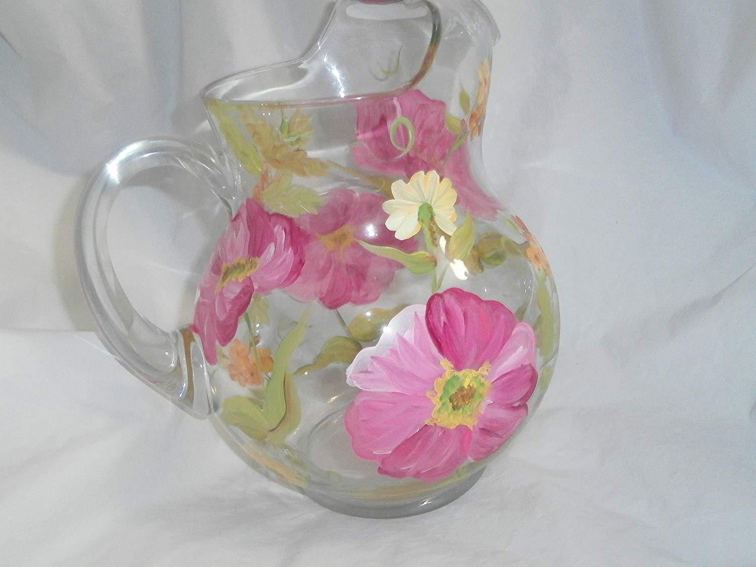 Hand painted pink poppies. Accented with orange and yellow posies. Round 66 ounce pitcher. Soft and romantic. usa