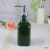 Dispenser bottle factory direct wholesale elegant green ceramic bathroom accessory set custom logo bottle jar