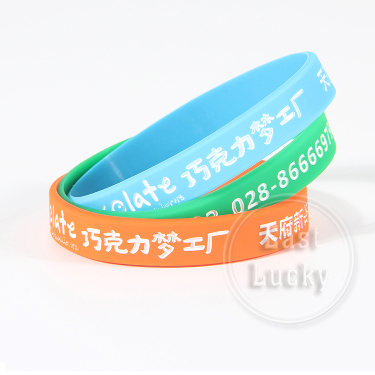 Cheap price debossed silicone hand bands with color filled