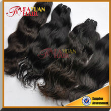 Natural color unprocessed 5a natural wave hair quality brazilian human hair sew in weave