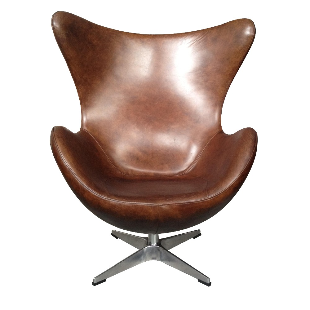 classic brown leather swivel egg chair in living room