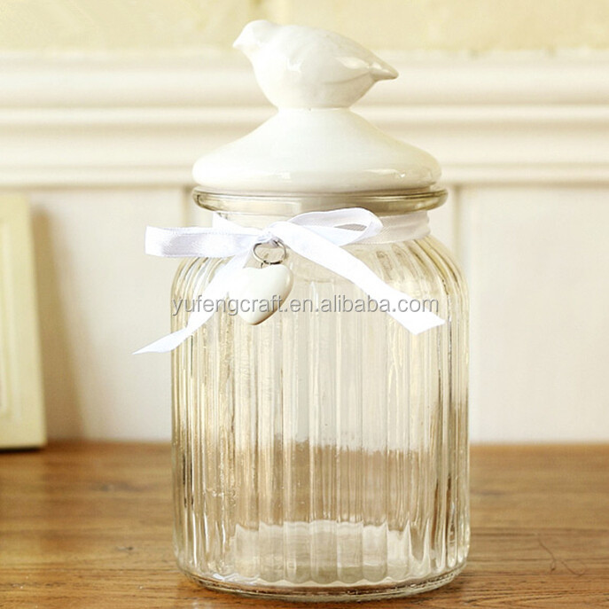 glass storge jar with plaster animal lid