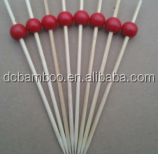 red color bead pattern bamboo sticks