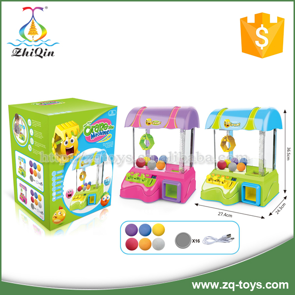 Kids coin operated claw toy game machine with light and music