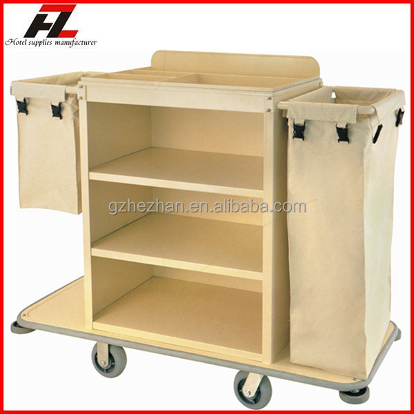 Hotel metal housekeeping cart with extra storage area on for Hotel room service cart