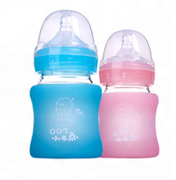 best selling glass/silicone baby feeding bottle