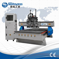 Best selling 3 heads 3.5kw spindle automatic tool changing cnc router machine 1325 ATC
