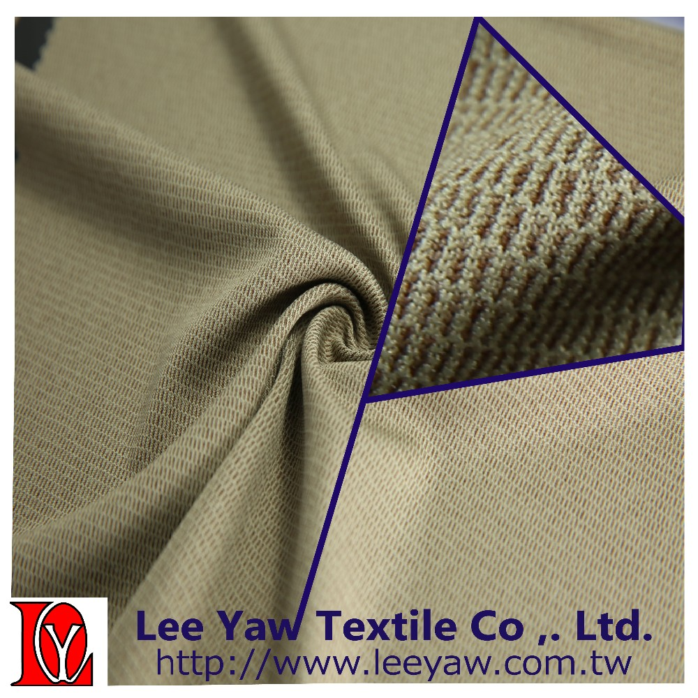 100% polyester heather 2 tone mini waffle fabric with permanent wicking