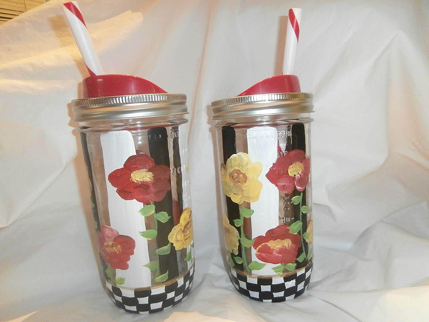 Hand painted Red and Yellow poppies on stripes and checks. 24 ounce mason quart jars with coordinated lid and straws. set of 2.