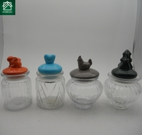 Small colorful ceramic lid glass storage jar