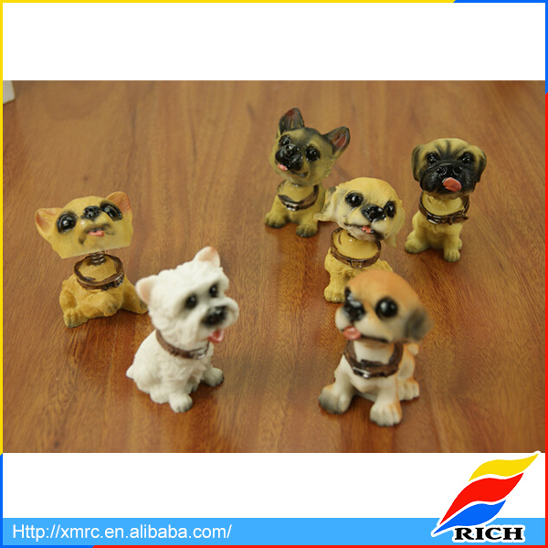 Hand painting small dog bobble head animals for dashboard