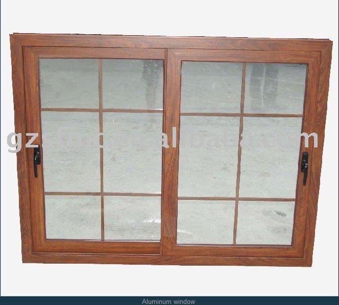 Ventana de aluminio con color de madera ventanas for Ventanas de aluminio con marco de madera