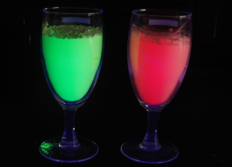 Vernice luminosa colori pigmenti con giallo bagliore verde colore ...