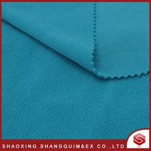 hot sale pure color blue one side brush polar fleece fabric with warm keep for man ski jacket