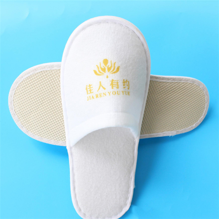 Disposable thick sole nonwovens logo custom antiskid 100 cotton lady Bathroom spa slippers