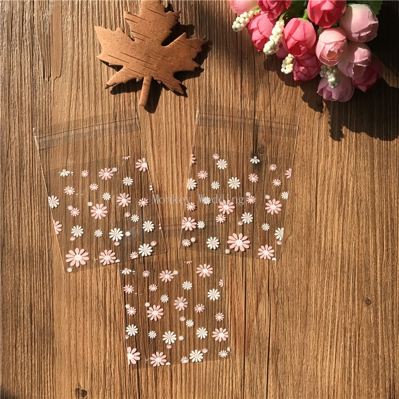 100pcs lot white ans pink flower plastic biscuit packaging bags cookies  packing cake tools Soap Bags 7cm 7cm - us213 a118229fbd699