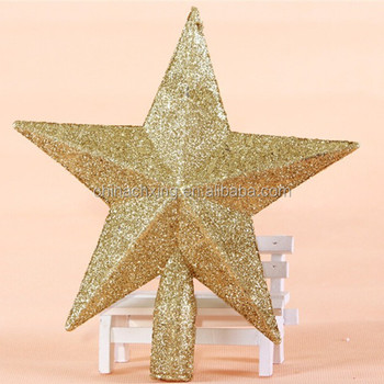 Plastic Christmas Stars With Gold Color Glitters On The Top Of The