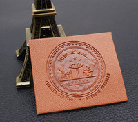 Wholesale custom brand name genuine embossed leather clothing labels