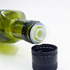 olive oil cap with plastic non-refillable insert