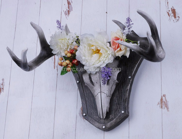 Resin deer antler wall mounted and then decorated with flower