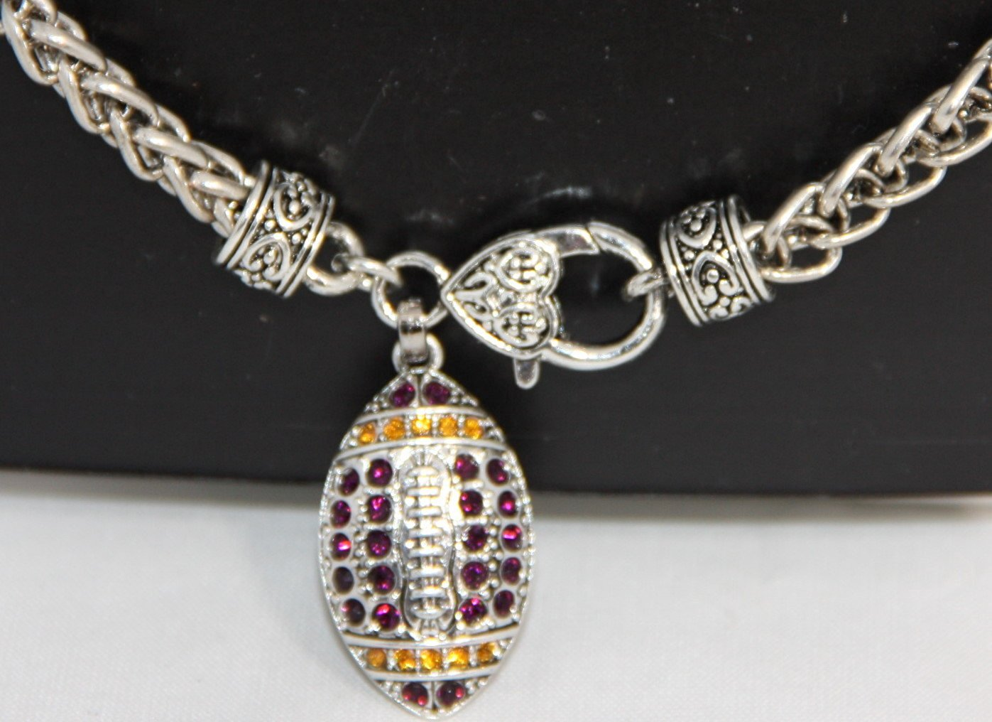 LSU Tigers or Minnesota Vikings Purple & Gold 1 1/4 inch long Rhinestone Football Charm on 7 1/2 Heavy Bracelet with Heart Lobster Claw Clasp - Rhinestone Sparkle!!! The Ultimate Way to Show your Pride in LSU Football & Louisiana State University Students!!