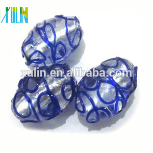 Murano style lampwork marking off oval glass beads