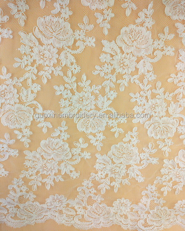 In-stock jacquard mebroidery lace fabric in ivory for wedding dress and women dress