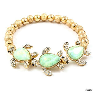 Awesome Selection of Chic Fashion Jewelry Minty Turtle Charm Gold Ball Stretch Bracelet