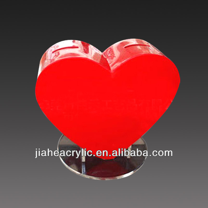 red heart shaped acrylic fish bowl