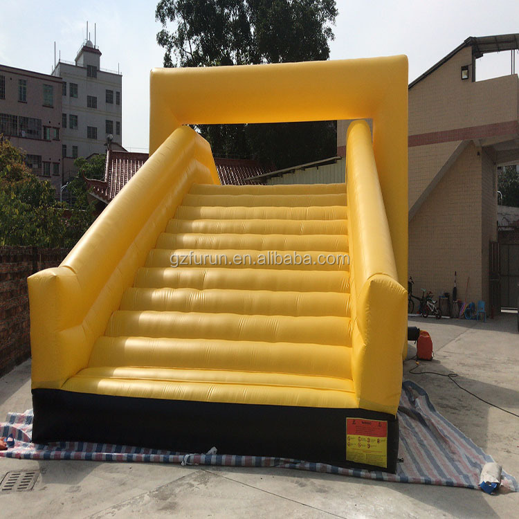 Yellow slide and glide inflatable 5k run obstacle course slide