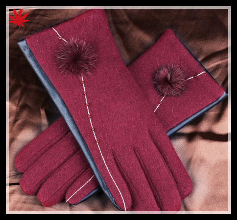 ladies back woolen and palm pu leather together style gloves have small fake fur ball