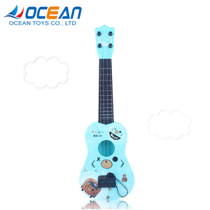 Kids cute musical mini guitar instrument color ukulele with plectrum