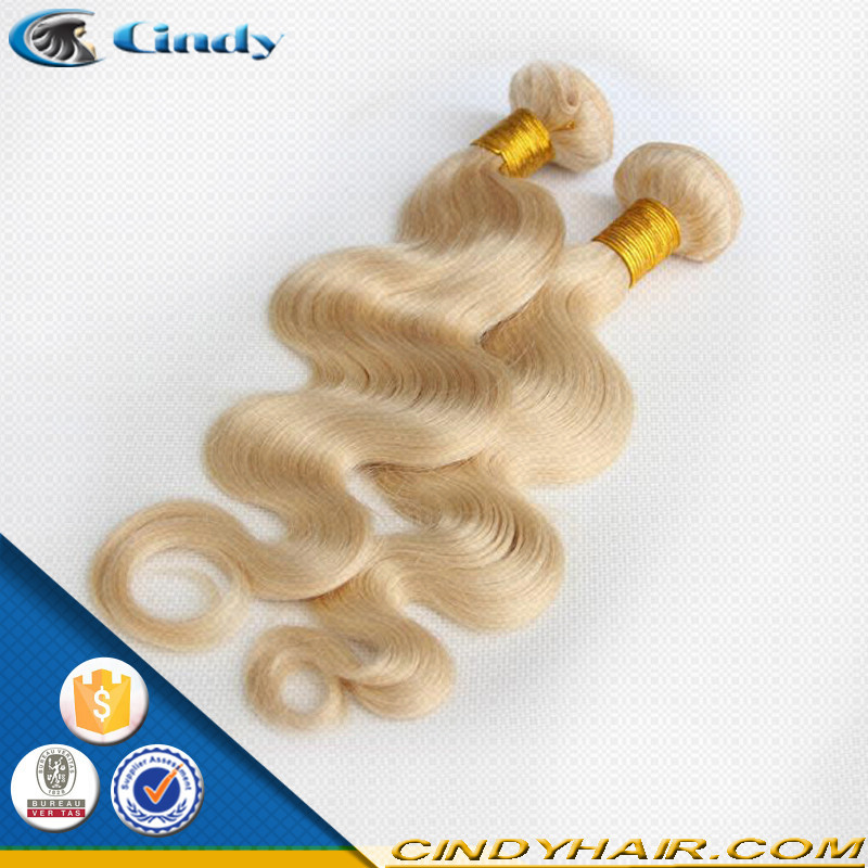 wholesale 7A grade unprocessed 100 unprocessed virgin remy human peruvian curly honey blonde wavy hair weave 28 inch