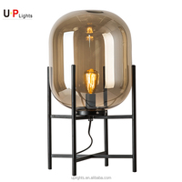 New style amber glass and black metal leg table lamp design