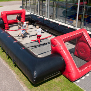 Black and red Inflatable human table football Soccer field