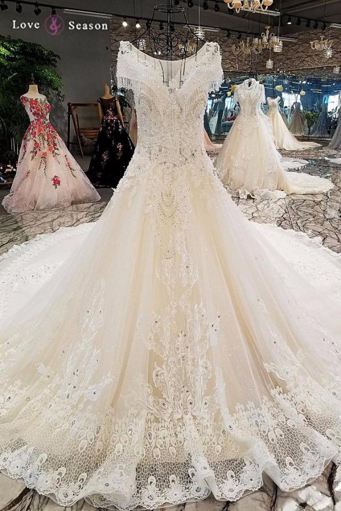catálogo de fabricantes de vestidos de boda kleinfeld de alta