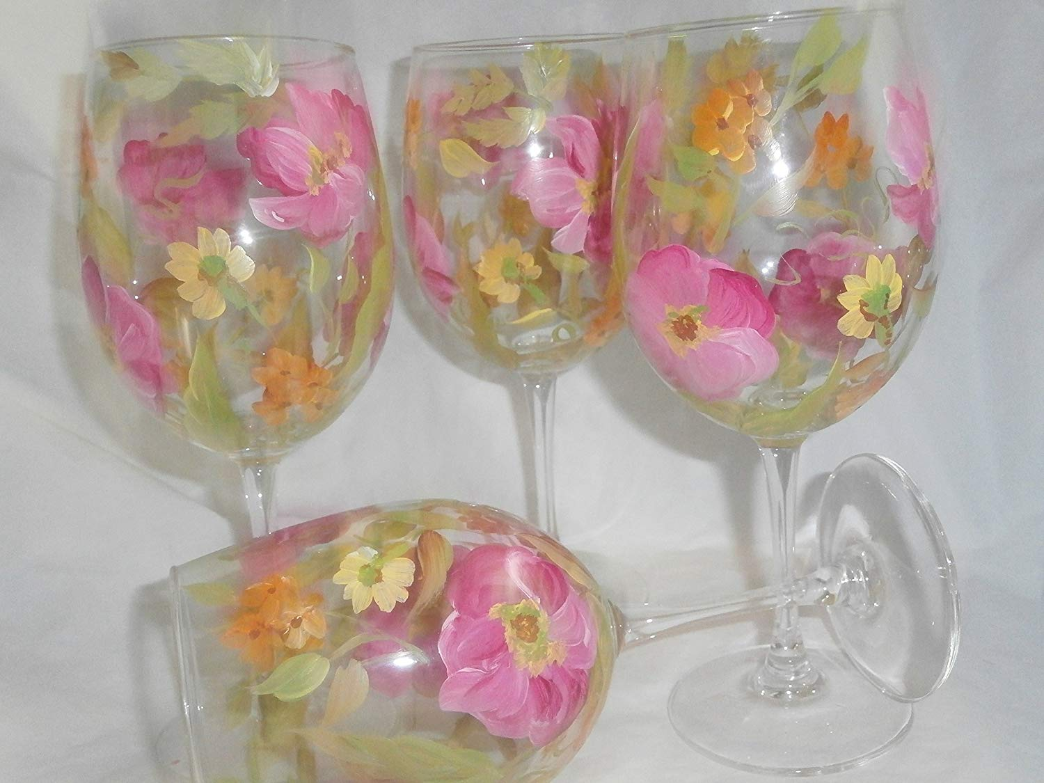 Hand painted pretty pink poppies. Accented with yellow and orange poppies. . Set of 4 goblets.. 12 ounces each.